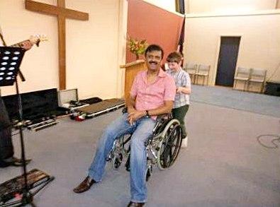 Gods' evangelist Ram Babu pushed by Josiah O'Brien, God's healed .