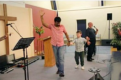 Ram Babu, Josiah and his dad celebrating Josiah's healing.